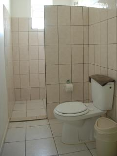 All studios have a shower with hot and cold running water, toilet, sink and storage shelves.