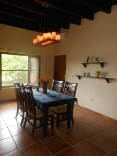 Candle Chandelier in dining area.( Taken before tropical curtains were hung)