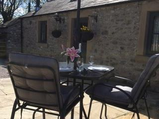 Keepers Cottage has a lovely patio with beautiful views and comfortable seating.