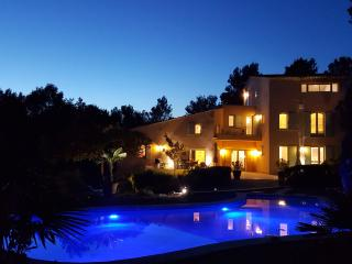 The house and pool lit at night
