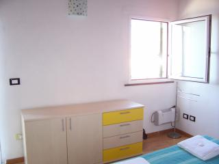 A PART OF THE BEDROOM WITH THE BALCONY