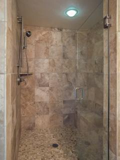 Spacious Master shower with tiled bench