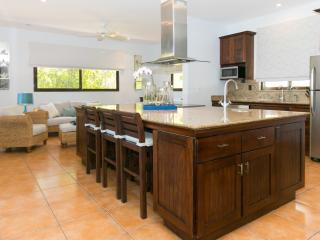 Kitchen granite breakfast bar and casual living area