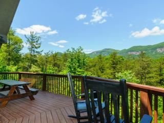 Enjoy outdoor meals or just relax in the rocking chairs on the large deck with mountain views.