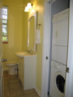 Bathroom with full size washer and dryer
