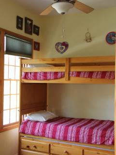 his room has THREE twin bunk beds - one is a trundle.