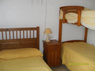 Second bedroom with single bed and 2 bunk beds