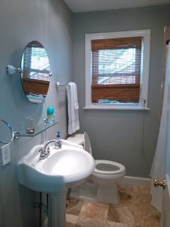 Full bath between bedrooms.  Closet holds hair dryer, first aid supplies, toiletries and towels, etc