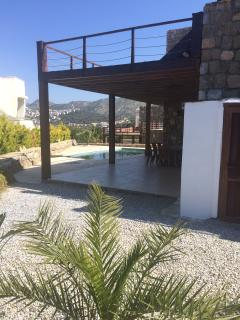 Side of villa with pool