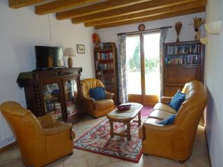 Comfortable lounge, leading onto sunny patio, with leather sofa + armchairs, TV + DVD player.