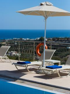 The pool are is equipped with sun beds and umbrellas.