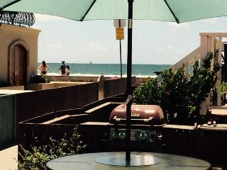 Sit down ocean view from large patio bbq deck.  Seats 20+.  Steps from beach. Shared.