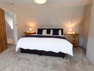 One of the master bedrooms with super king size bed that can be twinned