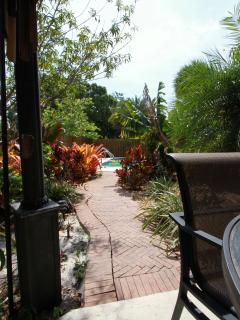 View from pagoda, through zen garden to pool area. All privacy fenced