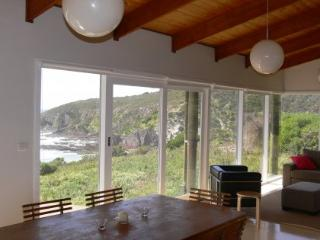 Open plan living area with picture windows that capture the unspoiled views.