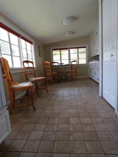 Sunroom & eat-in kitchen, beyond pantry area & butlers pantry