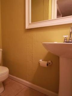 Bath in safety shelter. Toilet & pedestal sink