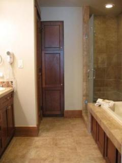 Master Bathroom - En suite master bathroom features double sinks, large walk in shower, a jetted tub, and a separate...