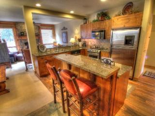 Kitchen - The well appointed kitchen features granite counters and stainless steel appliances.