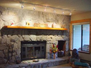 Fireplace - This is a GREAT wood-burning fireplace made of authentic river stone that is a fitting centerpiece to this home.