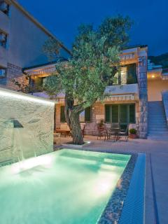 The villa is designed in a distinctive Mediterranean style of stone, while the interior is equipped