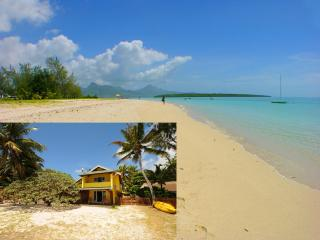 Villa Easternwind  literally on the sand ! Great swimming and snorkeling ..
