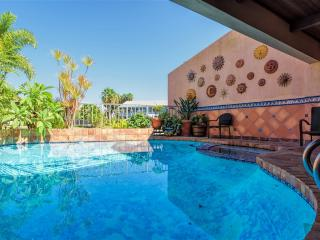 Casa de las Palmas: Charming WATERFRONT townhome with PRIVATE POOL & BOAT SLIP!