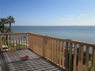 Bayfront sunsets, private master suite and boatslip!, South Padre Island