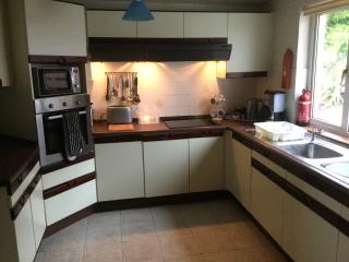 Kitchen with lots of equipment inc. slo cooker, juicer,coffee machine, washer etc