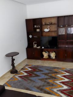 large sitting room with flat screen tv