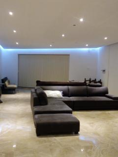 large open plan living room with lit up soffit