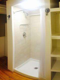Full bathroom with new premium shower located off laundry room on first floor.