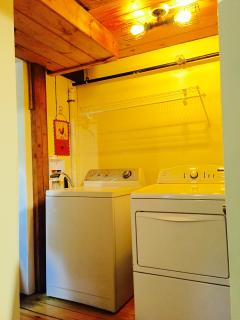 Washer and dryer located on 1st floor off mudroom.