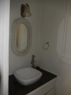 Powder room on lower floor (half bathroom)
