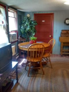 Living/Dining Room,  with braided rug and antique round table