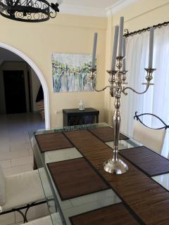 Dining area with hand-made oil paintings from alocal artist