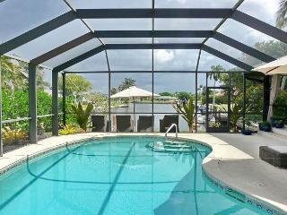Waterfront house on corner lot w/ big, heated pool & spacious yard