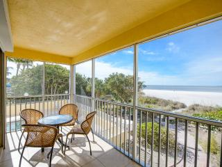 Front Balcony overlooking the beach and ocean. Just relax, listen to the surf, and watch the sunsets