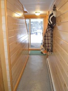 Basement hallway to 2 bedrooms and full bathroom and laundry areas