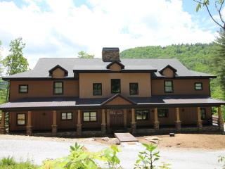 The back of the house overlooks beautiful Sapphire Valley - you can walk out to the activity field.