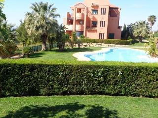 Sierra Cortina apartment with a  garden, sea view