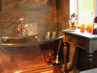 magnificent copper bath tub in refurbished bathroom with underfloor heating