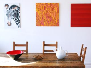 in-house gallery and ten seater rustic table