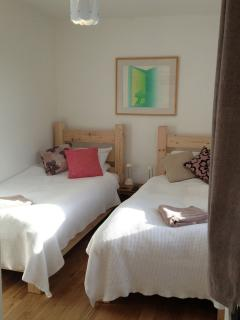 room 3. twin with en-suite and oak flooring