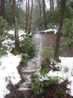 Waterfall on the property surrounded with snow.