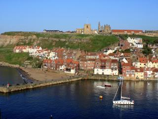 Whitby Harbour looking towards St Mary's Church and Whitby Abbey