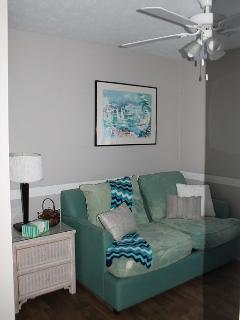 spare bedroom love seat and single bed