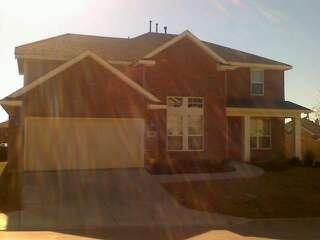 Bright sunny day in texas shining on front of house