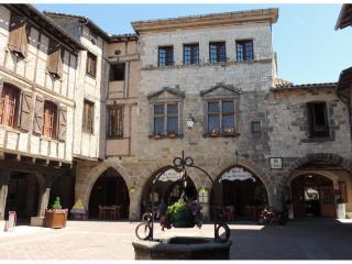 Castelnau, closest village.  Cafe terrace is centre of area's social life, tuesday market