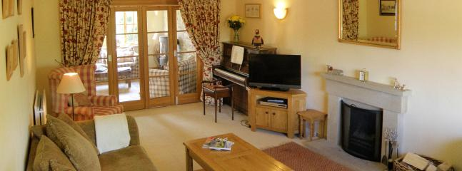 The formal sitting room, with TV, DVD, open fire ... and a piano